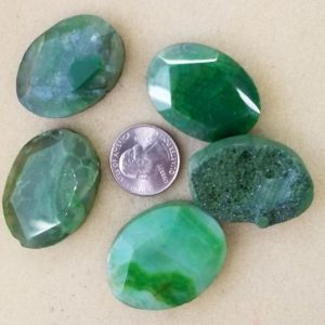 2275 faceted green rough stone